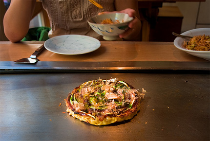 Okonomiyaki being grilled