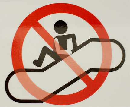 No jumping off escalator sign