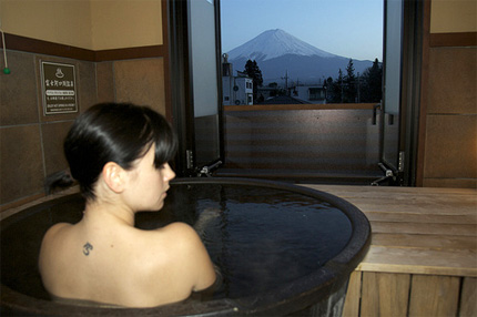 Woman bathing at Japanese onsen