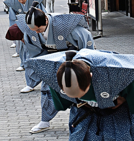 Japanese men bowing