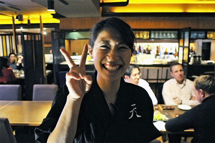 Japanese waitress smiling